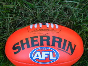 aussie rules football on the grass