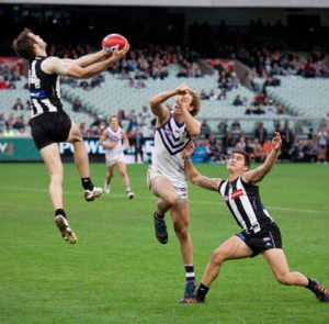 aussie rules player catches the ball