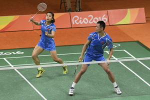 badminton mixed doubles team playing