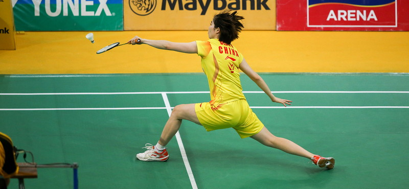 badminton player taking a stooping shot