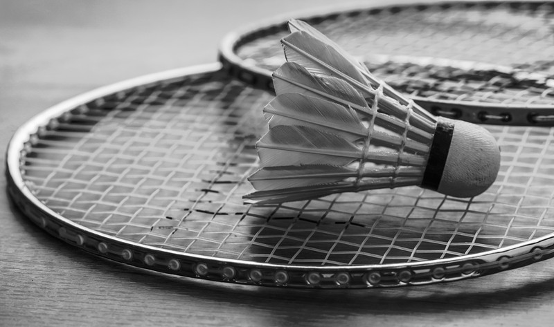 badminton raquets and shuttle cock in black and white