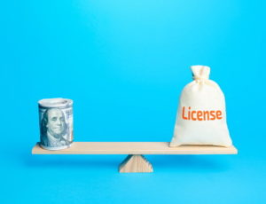 balance with licence one end and money the other