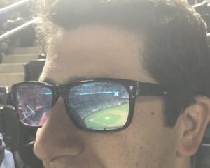 baseball game relfected in sunglasses