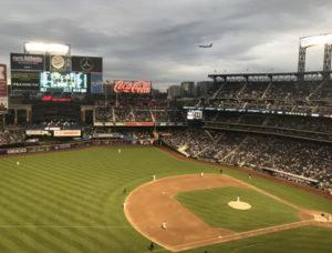 baseball match at citi field with plane landing