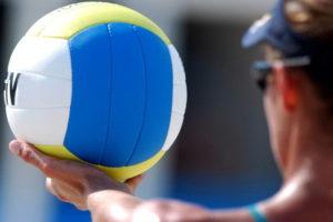 beach volleyball man serving close up