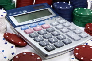 calculator with casino chips