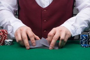 croupier shuffling decks of cards