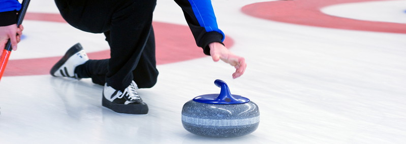 curling player releases stone