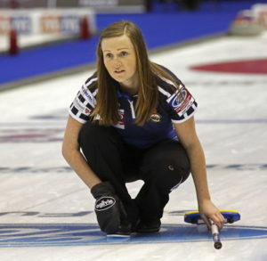 curling Scottish player follows stone