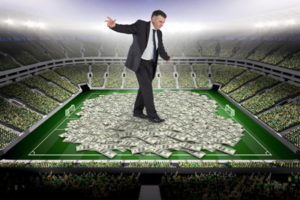 football pitch covered in money