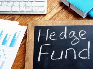 hedge fund written on chalk board by computer