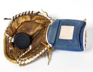 ice hockey old puck and glove