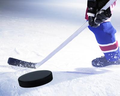 ice hockey stick and puck