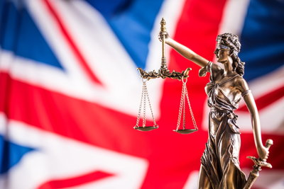 lady justice and uk flag