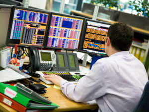 man trading investing at a desk