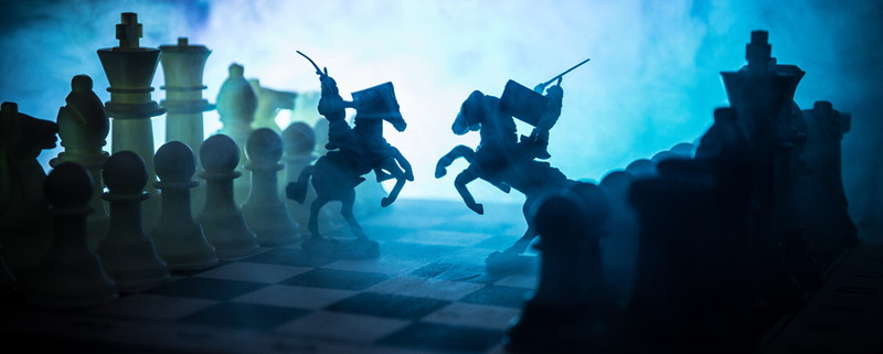 medieval style battle between knights on a chess board