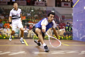 player reaches for the ball in a squash match