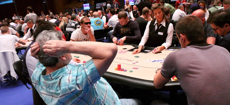 player sits back during a poker game