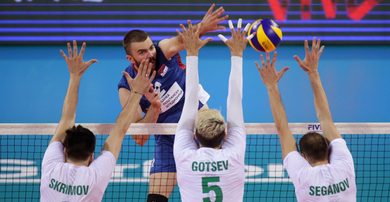 players fight at the net in a volleyball match