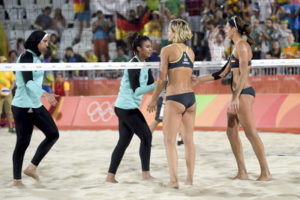 players shake hands in womens olympic beach volleyball match