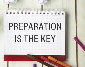 preparation is the key written on a note pad