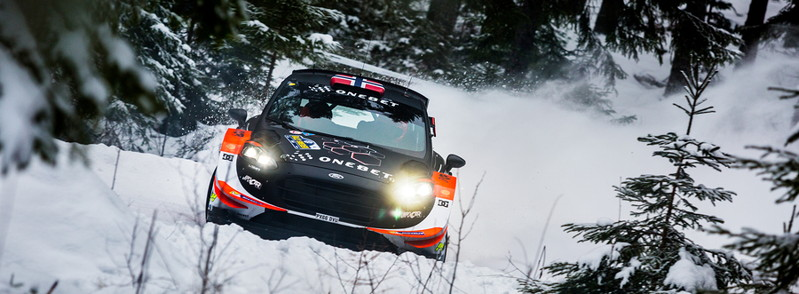 rally car in thick snow