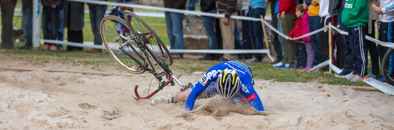 rider falls off cyclo-cross bike on sand