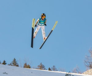ski jumper mid air