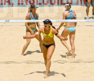 spanish beach volleyball player wins a point and celebrates