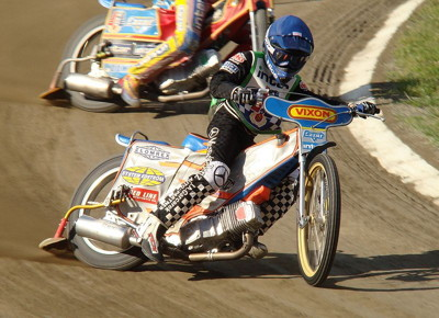 speedway rider in race close up