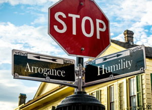 stop sign arrogance and humity arrows overconfidence