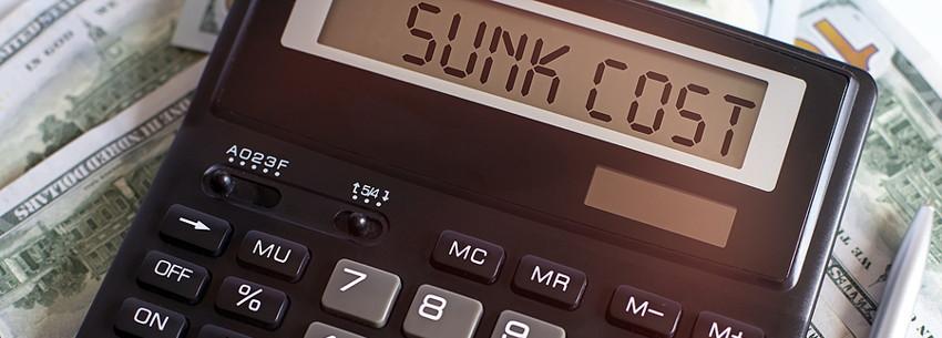 sunk cost written on calculator