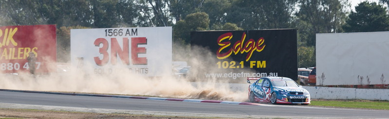 supercar skids off the track