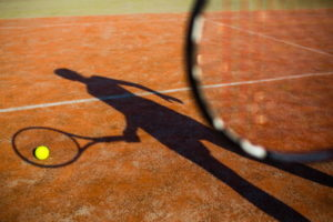 tennis player silhouette on court