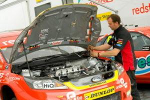 touring car mechanic fixing engine