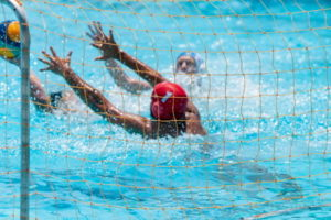 water polo goal keeper makes a save